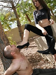 Mistress tied man to the tree and made him lick feet