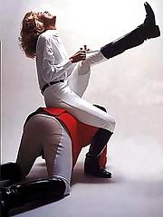 Mistress sits on slave
