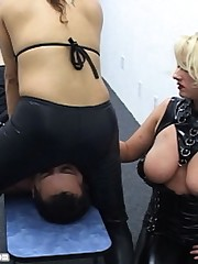 Two latex dominatrixes trained a slaveboy by their asses