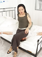 Dominatrix in pantyhose sat on manslave