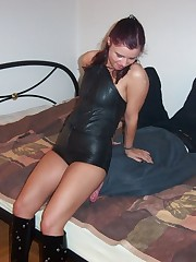 Chick in leather dress sat on man's face