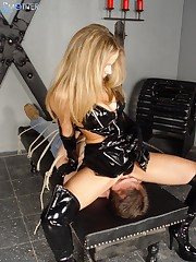 The blonde worn in black lated sits on slave