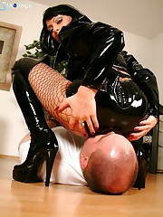 Slut in latex was sitting on the slave.