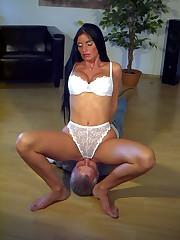 Hot dominatrix sitting on her man