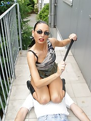 Sexy lady in leather boots makes her sub obey her