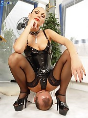 The mistress worn in corset sat on slave