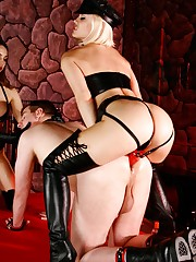 Mistresses Ash Hollywood and Tiffany Tyler make their wench submit to their large red strapon cocks