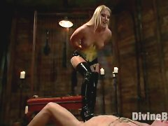 Ashley Edmonds suspends slaveboy from the ceiling and makes him lick her ass to orgasm