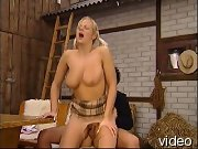 Pigtailed Blondie in stockings jumping a fat cock in the barn