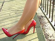 This sexy blonde looks fantastic in her red high heels outdoors