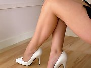 White high heels cover this babes naked feet