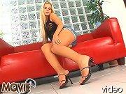 Blonde teenie pampered with oil her nice long legs