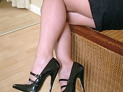 Black high heels look stunning on this horn babe