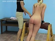 Two sexy blondes in caning action