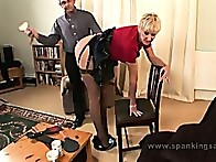 Scarlet has to bend over and take a hard thrashing and paddling