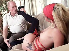 Blonde bombshell Jayden Rose giving a mature stud an awesome footjob in a sofa