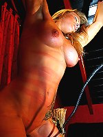 Blonde in corset receives full-body whipping.
