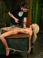 Blonde slave endures multiple torments