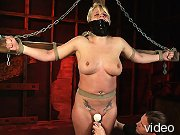 Pain slut is tied to a cross and gagged.