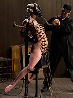 Blonde blindfolded and tightly bound in chains