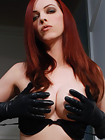 Emily Marilyn sexy leather gloved model in lingerie added to stockings