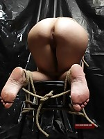Forced blowjob for rope-bound submissive brunette