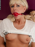 Blonde babe's mouth stuffed with red ball gag
