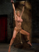 Pretty blonde is X-tied and caned