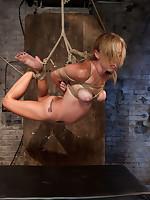 Blonde bound in hogtie suspension