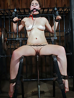 Brunette slave caged, bent over, gagged, fucked