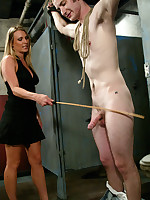 Two Dommes probe a man in both his orifices.