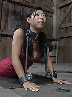 Heavy shackles for Asian submissive