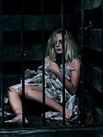 Brunette locked in tight metal cage