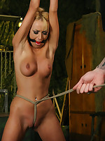 Blonde slave endures multiple torments