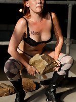 Predicament bondage for redheaded slavegirl