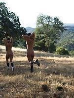 Outdoor bondage and calisthenics for two naked slavegirls