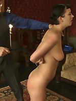 Slavegirl in partial rope suspension is forced to cum