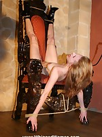 Blond bound upside-down to a chair and beaten mercilessly