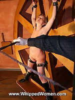 Woman is bound to the wheel and whipped upside-down