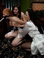 Two Dommes electrotorture a submissive in bondage