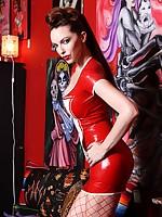 Emily Marilyn in flames rubber dominatrix nurse in fishnet stockings