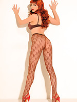 Emily Marilyn sultry redhead procurement off in weave print pantyhose
