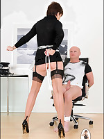 Domme in stockings ties slaveboy to a chair
