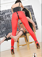 Domme in red rights teases slaveboy