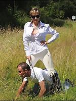 Mistress dominates her bottom boy outdoors
