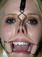 Sarah Jane Ceylon in medical straitjacket and latex bondage