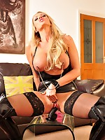 Hot Beauteous Mistress in hot latex rides her grand dark strapon