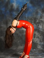 Beautiful babe Sammii is wearing a kinky outer taut red latex dress, the brush hands bound in leather coupled with the brush throat shindig gagged