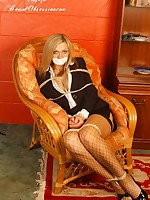 Sexy blonde indulge Bex is fastened in radiogram at her home enervating her sexy election suit and fishnet nylons
