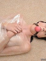 Slut Karina is wrapped in plastic. This babe is punished for the brush sins